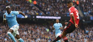 Manchester City 2-1 win over Manchester United: As city top Premier League table