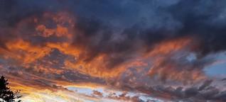 Wetter im Juli 2021: Himmel zeigt sowohl Regen als auch Sonne an